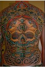 Whole body tattoos with full of skulls in many different colors.JPG