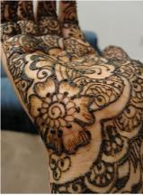close up picture of henna tattoos on the palm.JPG