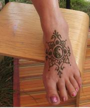Pretty foot henna tattoo looking cool.JPG