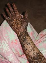 very pretty and elegant henna tattoos on whole arm and palm photos.JPG