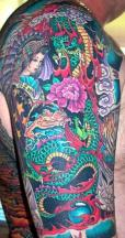 Bright colors tattoo with full of dragon and lady.JPG