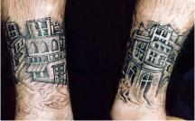 City building tattoos on the ankles.JPG