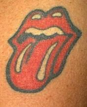 Tattoo of a mouth with tongue sticking out.JPG