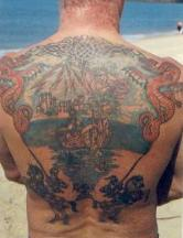 Big whole back tattoo with ship and island.JPG