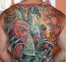 Colorful back tattoo with evil faces.JPG