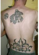 Up and low back tattoo photos.JPG