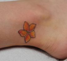 Tropical flower ankle tattoo in orange.PNG