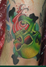 Bright green skull upside down tattoo.PNG
