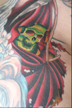 Green skull in red warior outfit tattoo.PNG