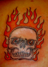 Picture of an evil skull tattoo with strong fire in the background.PNG