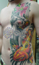 Body tattoo with gold fish and flowers.PNG