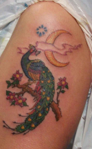 Beautiful bird in tree with yellow moon tatto picture.PNG