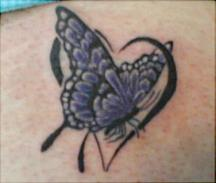 Dark blue butterfly tattoo with a heart