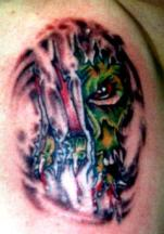 green demon tattoo