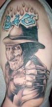 Scary face Freddy Krueger tattoo with hat