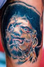 scarred face tattoo