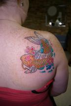 Koi tattoo in color on the back of the shoulder.jpg