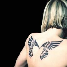 Geometric Angel wings tattoo.jpg