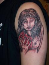 naked girls tattoo eating a bloody heart.jpg