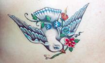 Flying dove tattoo